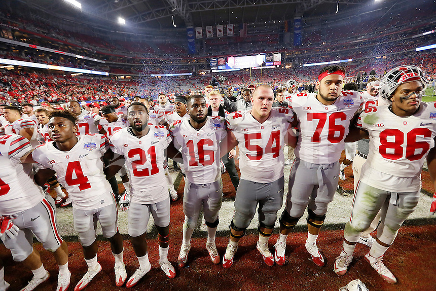 Ohio State Buckeyes sing Carmen Ohio following their 31-0 loss to Clemson in the College Football Playoff semifinal Fiesta Bowl at University of Phoenix Stadium in Glendale, Arizona on Dec. 31, 2016. (Adam Cairns / The Columbus Dispatch)