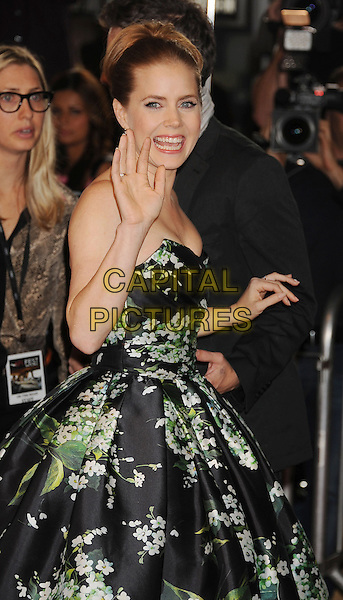 "Amy Adams.The 2012 AFI FEST - ""On The Road"" Gala Screening at Grauman's Chinese Theatre in Hollywood, California, USA..November 3rd, 2012.half length black green floral print smiling strapless dress hand arm waving side.CAP/ROT/TM.©Tony Michaels/Roth Stock/Capital Pictures"