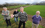 Kilgarvan GAA Club  officers, from left,  Jerh Lyne,  Thomas O'Reilly, Tom Randles, Chairman   and  Tadgh O'Donoghue, Secretary,  at the Kilgarvan GAA Club field . In background on left is part of the adjoining  Presbytery site . Picture: Eamonn Keogh (MacMonagle, Killarney)
