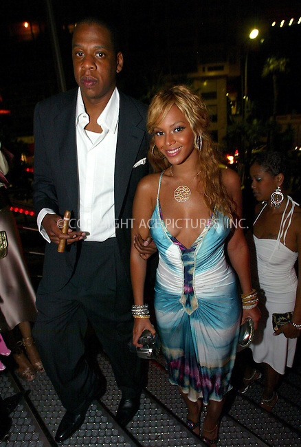 Jay Z and Beyonce Knowles at the Karement Summer Party, Karement Club, Monte Carlo, Monaco - 21/08/04..FAMOUS PICTURES AND FEATURES AGENCY.tel  +44 (0) 20 7731 9333.fax +44 (0) 20 7731 9330.e-mail info@famous.uk.com.www.famous.uk.com.FAM13406