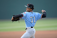 Starting pitcher Ronny Henriquez (31) of the Hickory Crawdads delivers a pitch in a game against the Greenville Drive on Wednesday, May 15, 2019, at Fluor Field at the West End in Greenville, South Carolina. Greenville won, 6-5. (Tom Priddy/Four Seam Images)