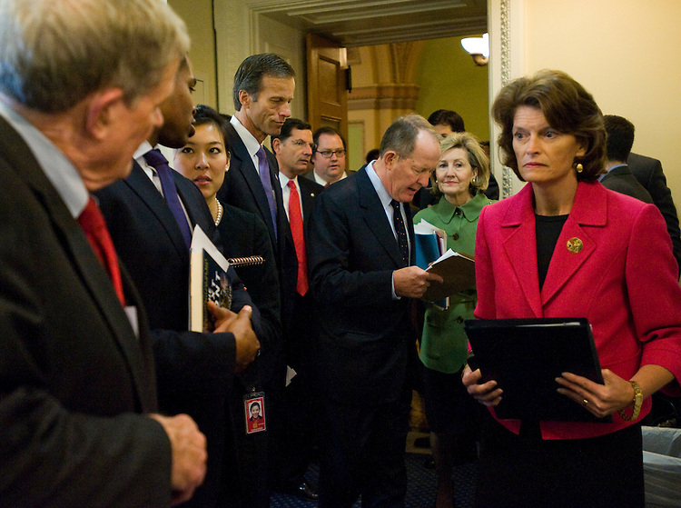 WASHINGTON, DC - Sept. 30: Sen. Christopher S. Bond, R-Mo., far left, Sen. John Thune, R-S.D., Sen. John Barrasso, R-Wyo., Sen. Lamar Alexander, R-Tenn., Sen. Kay Bailey Hutchison, R-Texas, and Senate Energy ranking member Lisa Murkowski, R-Alaska, gather before a news conference on a draft energy bill by Senate Foreign Relations Chairman John Kerry, D-Mass., and Senate Environment and Public Works Chairwoman Barbara Boxer, D-Calif., that would include measures aimed at climate change and reducing dependence on foreign oil. (Photo by Scott J. Ferrell/Congressional Quarterly)