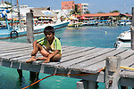 A boy on the dock. Isla Mujeras, Mexico
