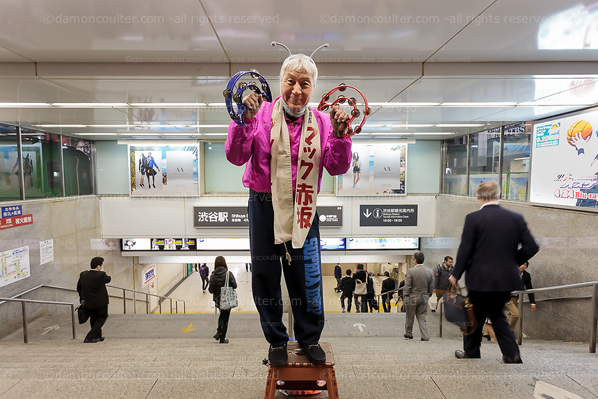 Mac Akasaka of the Japan Smile Party campaigning in his own unique style in Shibuya, Tokyo, Japan. Friday April 17th 2015