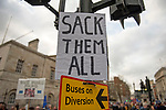 "A sign which says ""Sack em all"" on the route of the ""Put it to the People"" rally which made it's way through central London today. Demonstrators from across the country gathered to call for a second referendum on Brexit and to march through the UK capital finishing with speeches in Parliament Square opposite the Houses of Parliament in Westminster."
