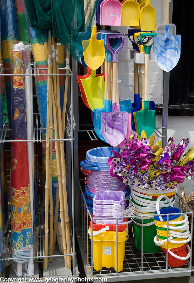 Traditional seaside buckets and spades on sale outside a shop in Aldeburgh, Suffolk, England
