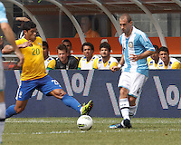 Argentina defender Pablo Zabaleta (4) passes the ball as Brazil forward Hulk (20) closes. In an international friendly (Clash of Titans), Argentina defeated Brazil, 4-3, at MetLife Stadium on June 9, 2012.