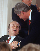 "United States President Bill Clinton, right, shakes hands with former White House press secretary James S. Brady, left, during the ""Brady Bill"" signing ceremony in the East Room of the White House in Washington, D.C. on November 30, 1993.  Brady passed away on Monday, August 4, 2014.<br /> Credit: Ron Sachs / CNP"