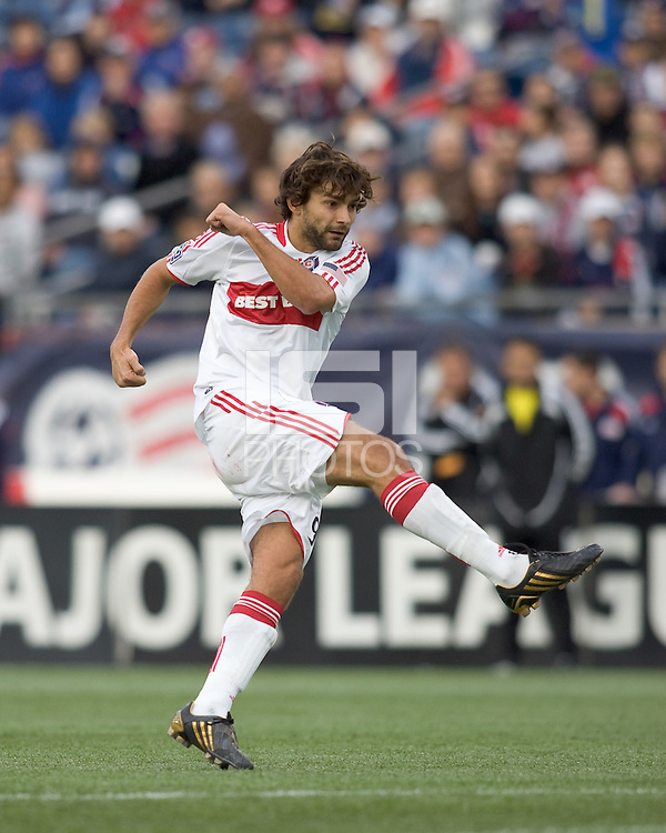 Chicago Fire midfielder Baggio Husidic (9) follows through on a shot. The New England Revolution out scored the Chicago Fire, 2-1, in Game 1 of the Eastern Conference Semifinal Series at Gillette Stadium on November 1, 2009.