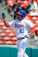 Buffalo Bisons outfielder Ryan Langerhans #23 after scoring a run during the first game of a doubleheader against the Pawtucket Red Sox on April 25, 2013 at Coca-Cola Field in Buffalo, New York.  Pawtucket defeated Buffalo 8-3.  (Mike Janes/Four Seam Images)