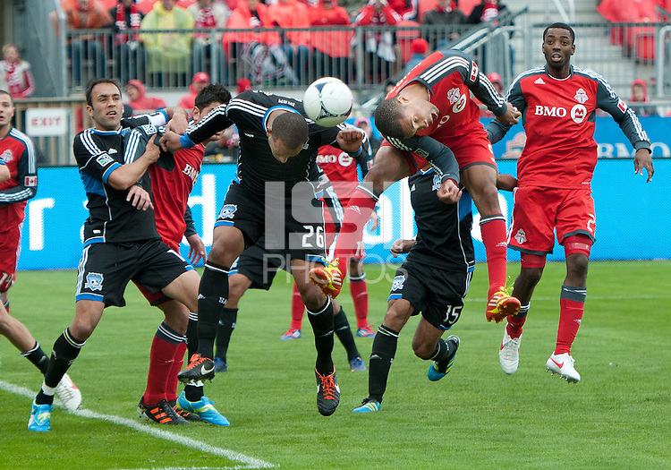 24 March 2012: San Jose Earthquakes defender Victor Bernardez #26 and Toronto FC defender Ashtone Morgan #5 in action during the second half in a game between the San Jose Earthquakes and Toronto FC at BMO Field in Toronto..The San Jose Earthquakes won 3-0..