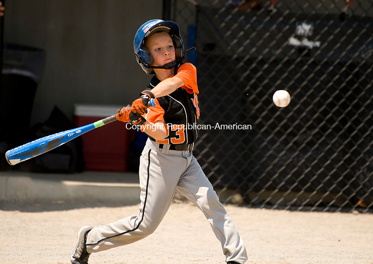 WATERBURY, CT-0712117JS11--Water-Oak's Brandon Lombardo (23) rips a two-RBI hit during their consolation bracket game against the Bonnie's of Brooklyn in the Roberto Clemente Tournament Thursday at the Waterbury PAL field. <br /> Jim Shannon Republican-American