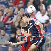 Chicago Fire midfielder Alvaro Fernandez (4) and New England Revolution defender Ryan Guy (13) battle for head ball. In a Major League Soccer (MLS) match, the New England Revolution (blue) defeated Chicago Fire (red), 1-0, at Gillette Stadium on October 20, 2012.