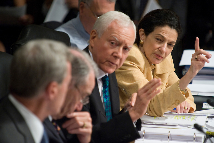 "From right, Sen. Olympia Snowe, R-Maine, and Sen. Orrin Hatch, R-Utah, try to get the attention of chairman Max Baucus, left, during the Senate Finance Committee's markup of ""The America's Health Future Act"" on Wednesday, Sept. 23, 2009. Sen. Kent Conrad, D-N. Dak., Sen. Jay Rockefeller, D-W.Va., are in the foreground."
