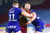 Picture by Alex Whitehead/SWpix.com - 08/02/2018 - Rugby League - Betfred Super League - Huddersfield Giants v Warrington Wolves - John Smith's Stadium, Huddersfield, England - Huddersfield's Jordan Rankin is tackled by Warrington's Ben Currie and Chris Hill.