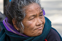 Nepal, Kathmandu, Swayambhunath.  Middle-aged Woman with Nose Ring and Nose Pin.