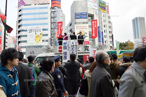 December 6, 2014, Tokyo, Japan - Yoshihiko Noda, Japan's former prime minister from the Democrtic Party of Japan, addresses a crowd during his pep talk for a local DPJ candidate in his stumping stop at Tokyo Ikebukuro on Saturday, December 6, 2014. The main opposition DPJ is estimated to win around 70 seats in the December 14 election for the parliament's lower house, up from 59 before the dissolution of the chamber but below its target of 100. (Photo by Natsuki Sakai/AFLO) AYF -mis-
