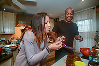 Kevin Overton, of Philadelphia watches as his sister Sally Armstrong of Dallas, Texas tastes his cooking Saturday, May 19, 2018 in Philadelphia, Pennsylvania. Sally Armstrong used a 23andMe Health + Ancestry kit to find her four half siblings. She met them for the first time Friday. (Photo by William Thomas Cain/CAIN IMAGES)