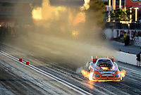Oct. 27, 2012; Las Vegas, NV, USA: NHRA funny car driver Todd Lesenko blows an engine on fire during qualifying for the Big O Tires Nationals at The Strip in Las Vegas. Mandatory Credit: Mark J. Rebilas-