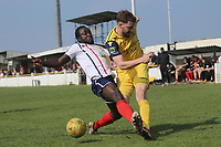 Bradley Warner of hornchurch gets in a cross from Kofi Gyebi of Witham during Witham Town vs AFC Hornchurch, Bostik League Division 1 North Football at Spa Road on 14th April 2018