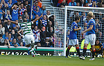 Baddur Ek Kaddouri celebrates after he shoots at Allan McGregor who fumbles his shot for Celtic's second goal.