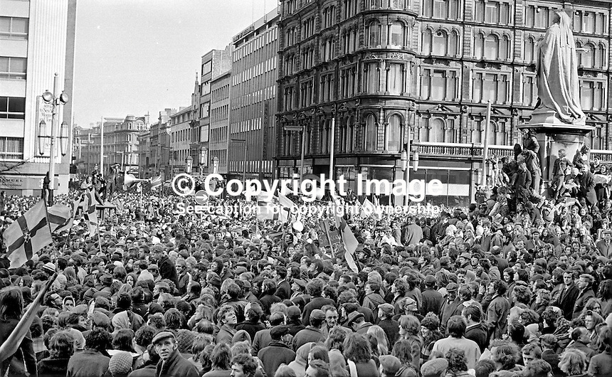 Thousands gather at the front of the City Hall, Belfast, in response to an Ulster Vanguard call for a 2 day strike to protest against the derogation of the N Ireland Parliament at Stormont and the introduction of direct rule by Westminster with the appointment of William Whitelaw as Secretary of State for N Ireland. Assembled gathering was address by William Craig, MP, leader, Ulster Vanguard. 197203270152b.<br />
