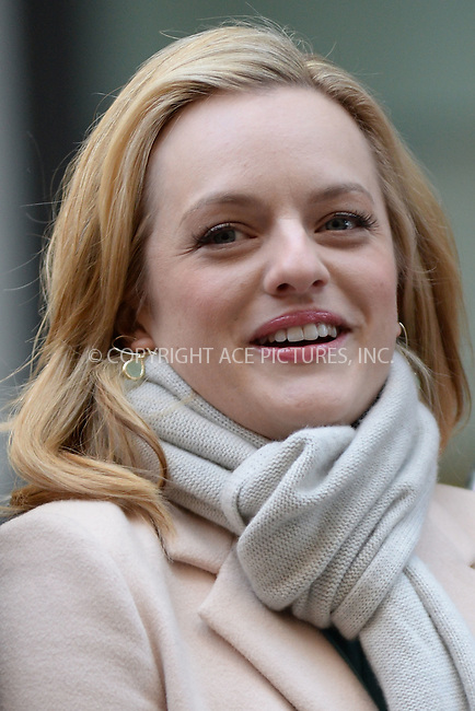 WWW.ACEPIXS.COM<br /> March 23, 2015 New York City<br /> <br /> Elisabeth Moss attending the 'Mad Men' art installation Unveiling at Time &amp; Life Building on March 23, 2015 in New York City. <br /> <br /> Please byline: Kristin Callahan/AcePictures<br /> <br /> ACEPIXS.COM<br /> <br /> Tel: (646) 769 0430<br /> e-mail: info@acepixs.com<br /> web: http://www.acepixs.com