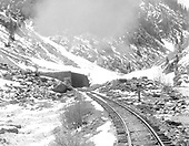 D&amp;RGW Silverton Branch snowshed in the distance.<br /> D&amp;RGW  Animas Canyon, CO  Taken by Dunscomb, Guy L. - 5/5/1942