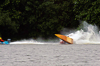 Frame 4: Marissa Affholder(151-M) races into turn 2 chasing 17-M and flips over. (stock outboard runabout)