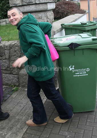 DUBLIN, IRELAND - JANUARY 04:  Irish musician Sinead O'Connor seems to have quickly changed her mind about divorcing her 4th husband, Barry Herridge.  Earlier today, Sinead tweeted that her and her new husband are back together.  The pair were spotted taking in the Greenstar bins at her home in Bray, Co. Wicklow. Sinead was more than happy for the photographers to snap pictures of the smile on her face, while Barry looked more serious and downcast.    on January 4, 2012 in Dublin, Ireland<br />