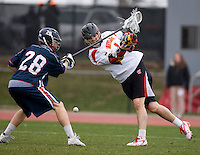 Grant Catalino (1) of Maryland has his shot deflected by Will Koshansky (28) of Penn at Ludwig Field in College Park, Maryland.