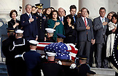 Former President George W. Bush, Laura Bush, and other family members watch as the flag-draped of former President George H.W. Bush is carried by a joint services military honor guard to lie in state in the rotunda of the U.S. Capitol, Monday, Dec. 3, 2018, in Washington. (AP Photo/Alex Brandon, Pool)