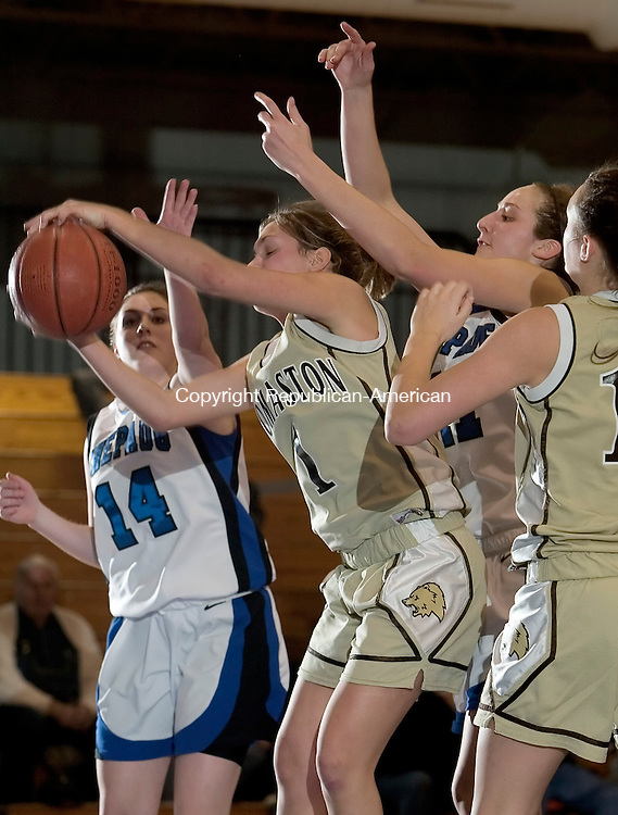 BURLINGTON, CT- 20 February 2008 --022008JS12--Thomaston's Brittany Brandt (1) pulls down a rebound in front of Shepaug's Stephanie Moots (14) and Samantha Steinmetz (41) during their Berkshire League semi-final game Wednesday at Lewis Mills High School in Burlington<br /> Jim Shannon / Republican-American