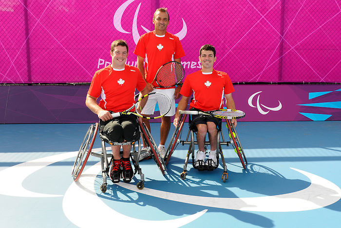London, England 26/08/2012 - Philippe Bedard, Christian Gingras and Joel Dembe of Wheelchair Tennis Canada pose for a group photo before a training session at the London 2012 Paralympic Games in Eton Manor. (Photo: Phillip MacCallum/Canadian Paralympic Committee)
