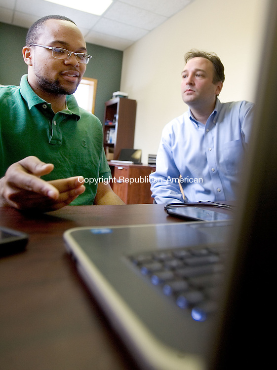 NEW HAVEN CT. 22 April 2014-042217SV06-From left, Ernest Turner, software engineer, and Bruce Seymour, managing director of MEA Mobile, work on a new mobile app at their office in New Haven Tuesday. Seymour says he is impressed with AT&amp;T's focus on upgrading infrastructure in the greater New Haven area, and he believes the level of investment would reinforce efforts to create a high-tech hub in New Haven.<br /> Steven Valenti Republican-American
