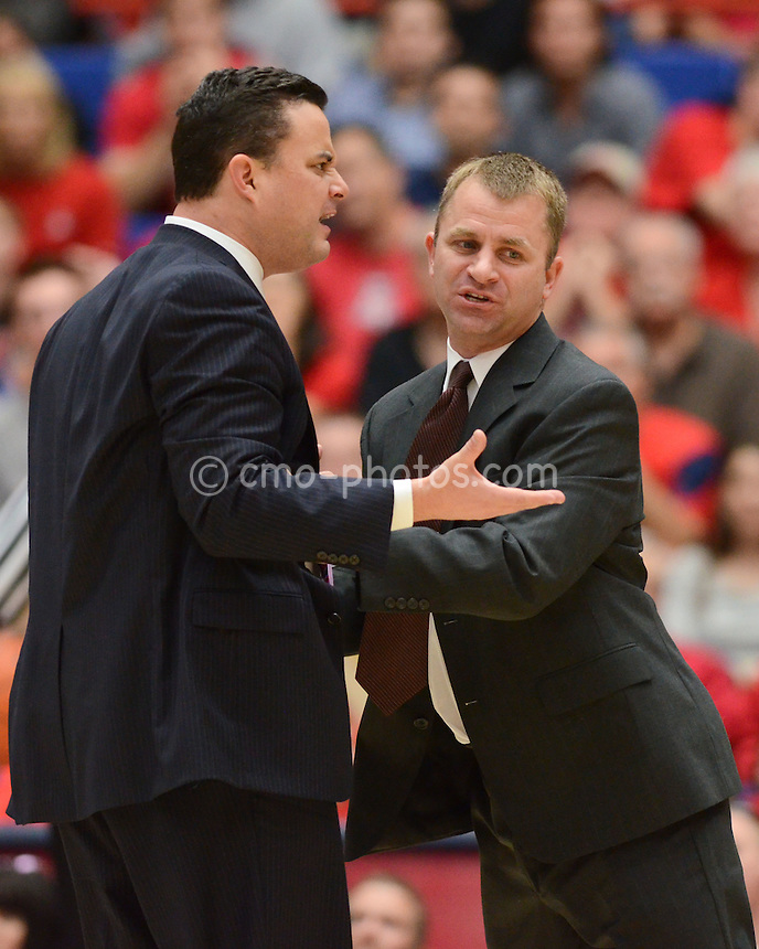 Nov 23, 2011; Tucson, AZ, USA; Arizona Wildcats head coach Sean Miller is restrained from an official by assistant coach James Whitford for a second time in the second half of a game against the San Diego State Aztecs at the McKale Center.  The Aztecs won 61-57.  Mandatory Credit: Chris Morrison-US PRESSWIRE