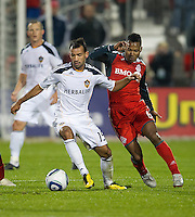 13 April 2011: Los Angeles Galaxy midfielder Juninho #19 and Toronto FC midfielder Julian de Guzman #6 in action during an MLS game between Los Angeles Galaxy and the Toronto FC at BMO Field in Toronto, Ontario Canada..The game ended in a 0-0 draw.