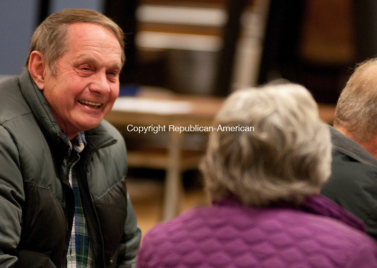 SOUTHBURY,  CT, 10 JANUARY  2012-011012JS03-Southbury Republican Town Committee candidate Edward Wildman, left, talks with a resident on Tuesday during the Southbury Republican Town Committee caucus Tuesday at Rochambeau Middle School in Southbury. .Jim Shannon Republican-American