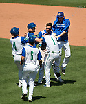 HARTFORD,  CT-071818JS16--Hartford's Brendan Rodgers (1) is greeted by teammates after hitting the game winning RBI during their game against Reading on Wednesday afternoon at Dunkin Donuts Park in Hartford.<br /> Jim Shannon Republican American
