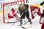 ADRIAN, MI - MARCH 18: Camille Leonard (31) and Maci Hoskins (6) of Plattsburgh State University block a shot from Maggie Mitter (10) of Adrian College during the Division III Women's Ice Hockey Championship held at Arrington Ice Arena on March 19, 2017 in Adrian, Michigan. Plattsburgh State defeated Adrian 4-3 in overtime to repeat as national champions for the fourth consecutive year. by Tony Ding/NCAA Photos via Getty Images)