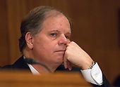 United States Senator Doug Jones (Democrat of Alabama) listens during testimony before the US Senate Committee on Banking, Housing, and Urban Affairs during the confirmation hearing for Jelena McWilliams, to be Chairperson and a Member of the Board of Directors of the Federal Deposit Insurance Corporation; Dr. Marvin Goodfriend, to be a Member of the Board of Governors of the Federal Reserve System; and Mr. Thomas E. Workman, to be a Member of the Financial Stability Oversight Council, on Capitol Hill in Washington, DC on Tuesday, January 23, 2018.<br /> Credit: Ron Sachs / CNP