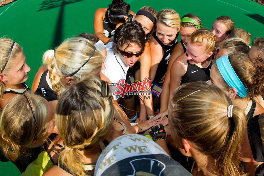 Wake Forest Demon Deacons head coach Jennifer Averill talks to her team prior to their match against the Liberty Flames at Kentner Stadium on September 13, 2013 in Winston-Salem, North Carolina.  The Demon Deacons defeated the Flames 3-2.  (Brian Westerholt / Sports On Film)