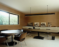 Patrick Gwynne designed the desk in his sleek hessian wallpapered ground-floor office