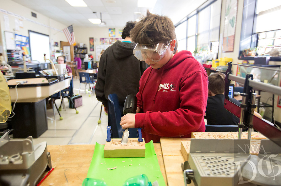 NWA Democrat-Gazette/JASON IVESTER<br /> Alex Ward shapes a car model on Wednesday, Feb. 8, 2017, at Old High Middle School in Bentonville. Six schools across the region recently launched fundraising campaigns for their maker spaces, which promote education through hands-on work using various tools, 3-D printers, circuitry kits and other materials.