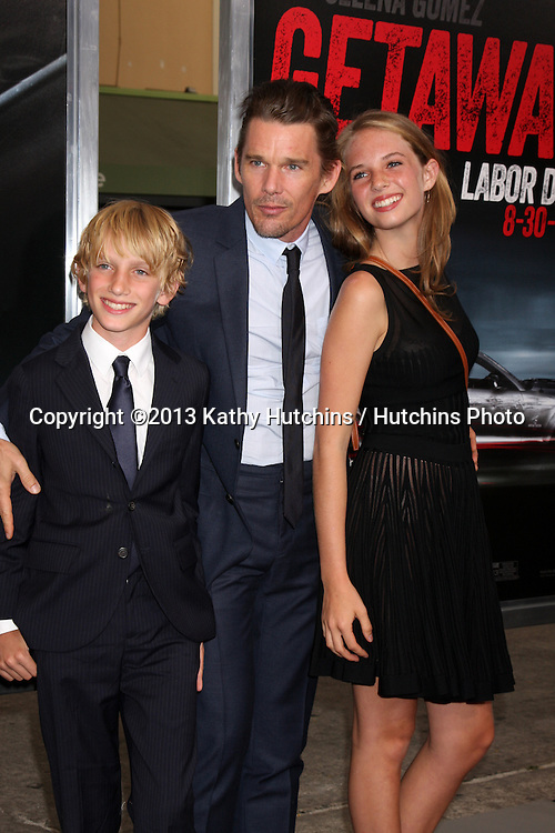 "LOS ANGELES - AUG 26:  Ethan Hawke, his children at the ""Getaway"" Premiere at the Village Theater on August 26, 2013 in Westwood, CA"