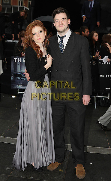 Rose Leslie and guest.'The Dark Knight Rises' European premiere at Odeon Leicester Square cinema, London, England..18th July 2012.full length grey gray suit black skirt jacket top.CAP/ROS.©Steve Ross/Capital Pictures.