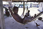 A Palauan youth rests in a hammock. The island republic of Palau has been everything from a Japanese military base to a U.S. Trust territory it now seeks profitable indignity as a plush Pacific resort..The Republic of Belau lies 1,300 kilometers, southwest of Guam, and 600 kilometers east of the Philippines. (Jim Bryant Photo).....