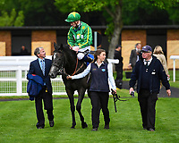 White Chocolate and jockeyDaniel Muscott are led into the winners enclosure after winning The British Stallion Studs EBF Fillies' Handicap, during Afternoon Racing at Salisbury Racecourse on 18th May 2017