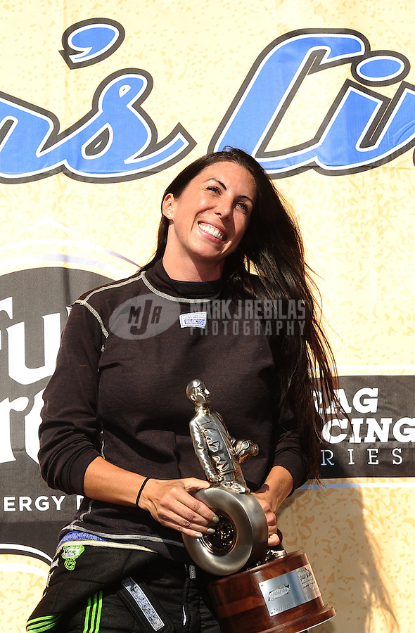 Aug. 7, 2011; Kent, WA, USA; NHRA top alcohol funny car driver Alexis DeJoria celebrates after winning the Northwest Nationals at Pacific Raceways. Mandatory Credit: Mark J. Rebilas-