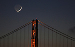 The crescent moon set behind the Golden Gate Bridge, San Francisco, CA.